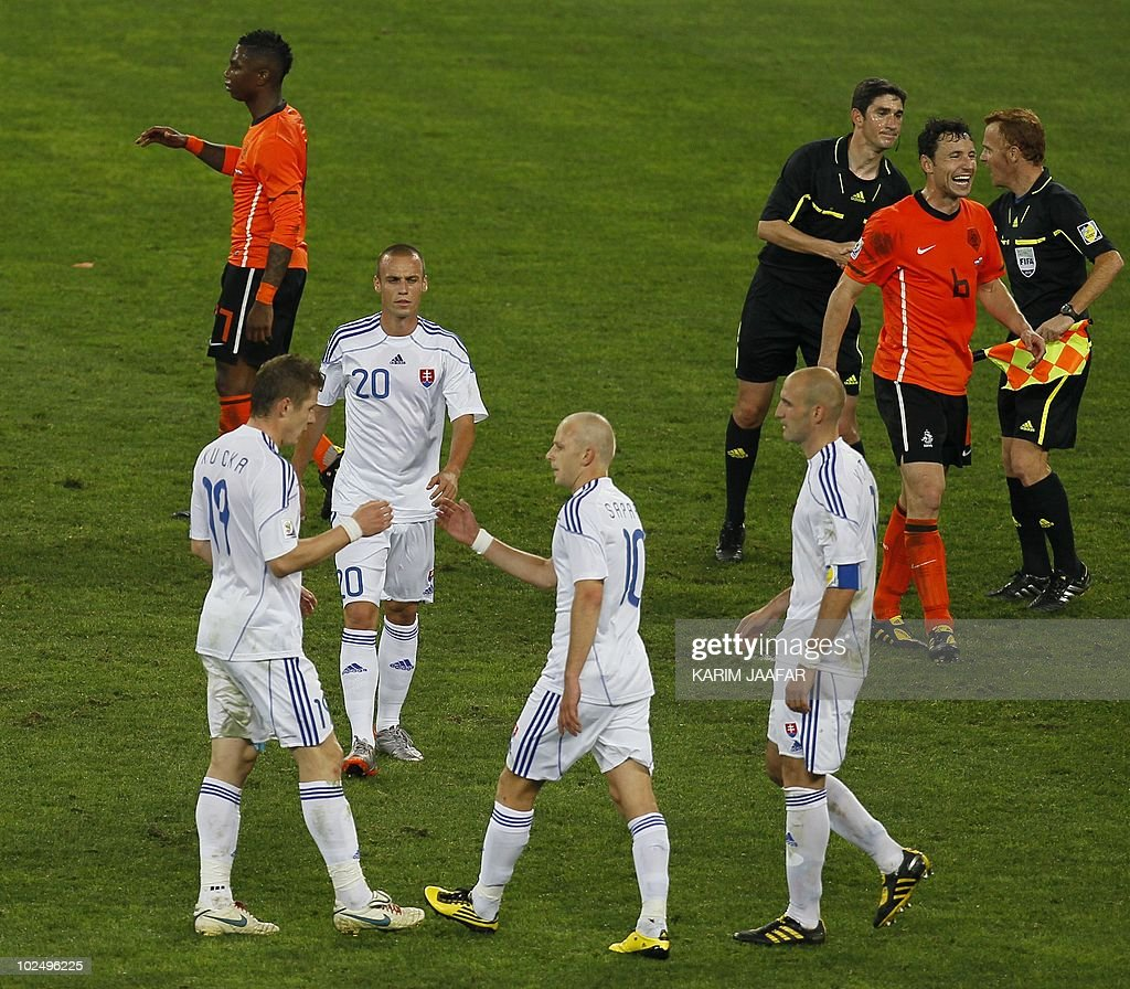 Slovakia's midfielder Kamil Kopunek (20), Slovakia's midfielder Marek Sapara (10) and Slovakia's striker Robert Vittek (11) deject as Netherlands' striker Robin van Persie (9) cheers after the 2010 World Cup round of 16 match Netherlands vs Slovakia on June 28, 2010 at Moses Mabhida stadium in Durban. Netherlands won 2-1. NO PUSH TO MOBILE / MOBILE USE SOLELY WITHIN EDITORIAL ARTICLE AFP PHOTO / KARIM JAAFAR