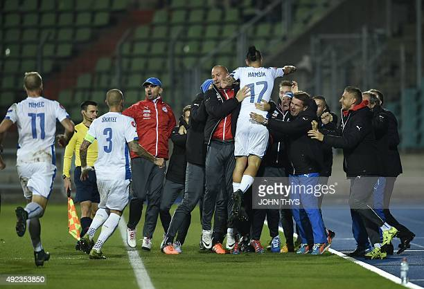 Slovakia's midfielder Marek Hamsik celebrates with his team after scoring during the Euro 2016 qualifying football match between Luxembourg and...