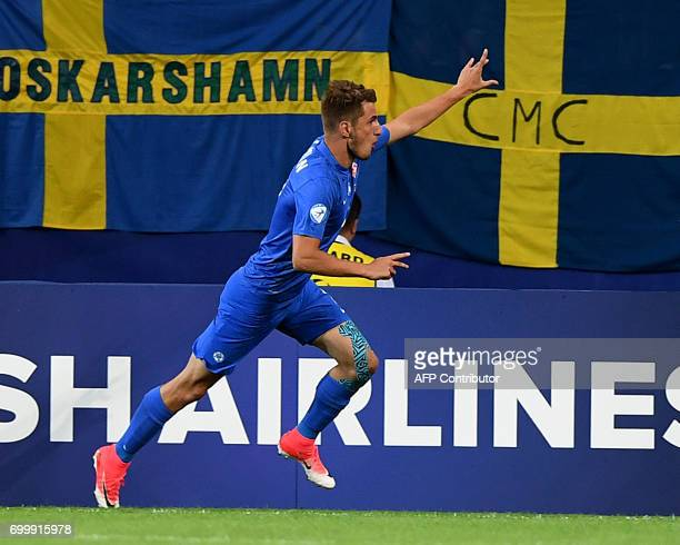 Slovakia's midfielder Martin Chrien celebrates scoring the opening goal during the UEFA U21 European Championship roup A football match Slovakia v...