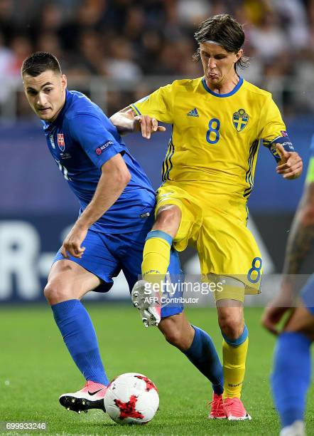 Slovakia's midfielder Matus Bero and Sweden's midfielder Kristoffer Olsson for the ball during the UEFA U21 European Championship roup A football...