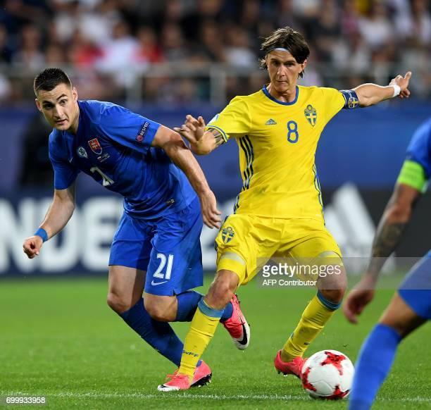 Slovakia's midfielder Matus Bero and Sweden's midfielder Kristoffer Olsson vie for the ball during the UEFA U21 European Championship roup A football...