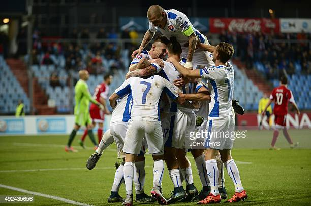 Slovakia's midfielder Robert Mak is congratulated by team mates after scoring a goal during an Euro 2016 qualifying football match between Luxembourg...