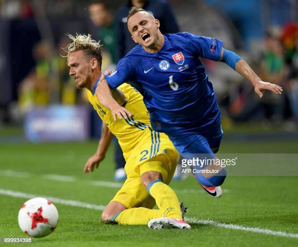 Slovakia's midfielder Stanislav Lobotka and Sweden's defender Linus Wahlqvist vie for the ball during the UEFA U21 European Championship roup A...