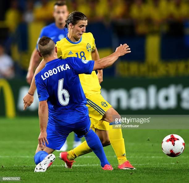 Slovakia's midfielder Stanislav Lobotka and Sweden's forward Pawel Cibicki vie for the ball during the UEFA U21 European Championship roup A football...