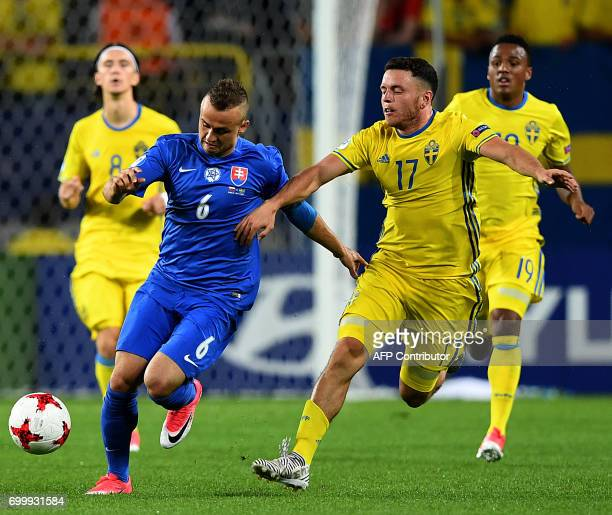 Slovakia's midfielder Stanislav Lobotka and Sweden's midfielder Kerim Mrabti vie for the ball during the UEFA U21 European Championship roup A...
