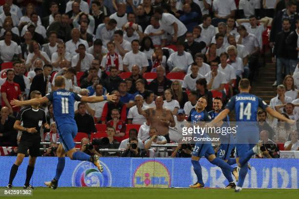 Slovakia's midfielder Stanislav Lobotka celebrates with teammates after scoring the early opening goal during the World Cup 2018 qualification...