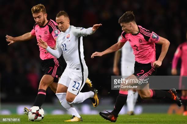 Slovakia's midfielder Stanislav Lobotka vies with Scotland's midfielder James Morrison and Slovakia's defender Peter Pekarik during the FIFA World...