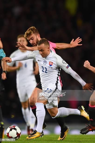 Slovakia's midfielder Stanislav Lobotka vies with Scotland's midfielder James Morrison during the FIFA World Cup 2018 qualifying football match...