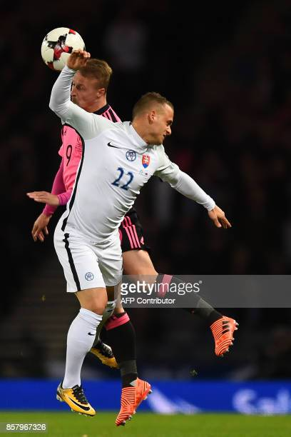 Slovakia's midfielder Stanislav Lobotka vies with Scotland's striker Leigh Griffiths during the FIFA World Cup 2018 qualifying football match between...