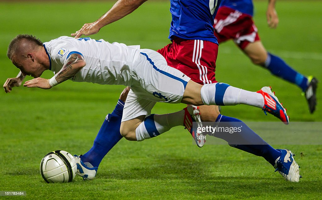 Slovakia's Miroslav Stoch falls during the World Cup 2014 qualifying football match between Slovakia and Liechtenstein on September 11, 2012 in Bratislava. AFP PHOTO/Stringer