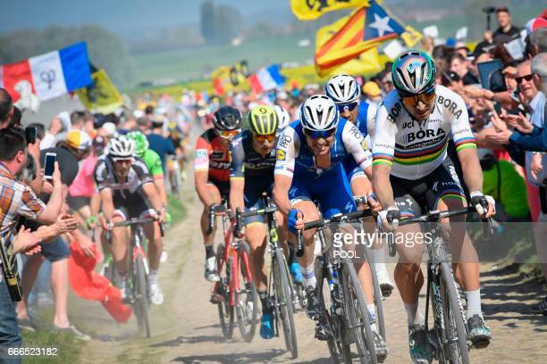 Slovakia's Peter Sagan and Czech Republic's Zdenek Stybar ride on the cobblestones during the 115th edition of the ParisRoubaix oneday classic...
