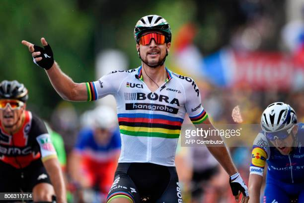 Slovakia's Peter Sagan celebrates as he crosses the finish line ahead of Belgium's Greg Van Avermaet and Ireland's Daniel Martin at the end of the...