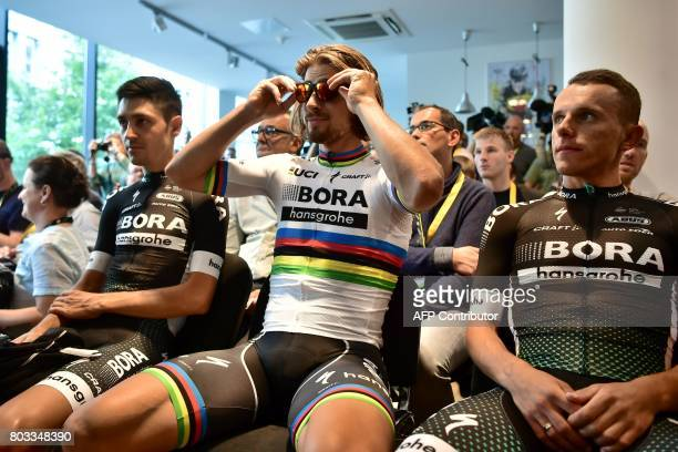Slovakia's Peter Sagan Germany's Emanuel Buchmann and Poland's Rafal Majka sit at a bike store prior to giving a press conference in Dusseldorf...