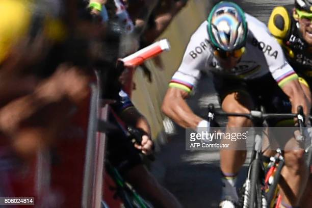 Slovakia's Peter Sagan gives a kick of elbow and Great Britain's Mark Cavendish falls near the finish line at the end of the 2075 km fourth stage of...