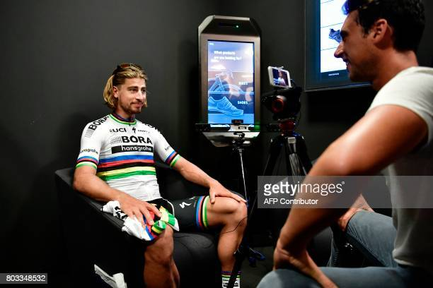 Slovakia's Peter Sagan gives a press conference at a bike store in Dusseldorf Germany on June 29 two days before the start of the 104th edition of...