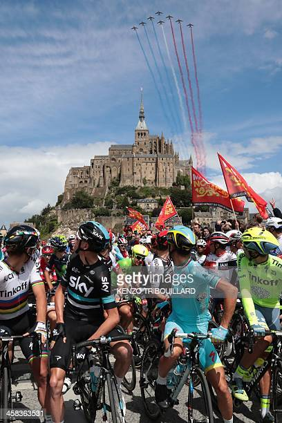 Slovakia's Peter Sagan Great Britain's Christopher Froome Italy's Vincenzo Nibali and Spain's Alberto Contador look at alphajets of the French Air...