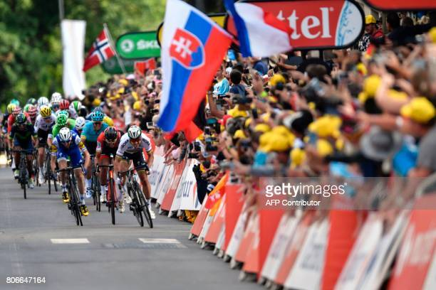 TOPSHOT Slovakia's Peter Sagan sprints towards the finish line past a flag of Slovakia at the end of the 2125 km third stage of the 104th edition of...