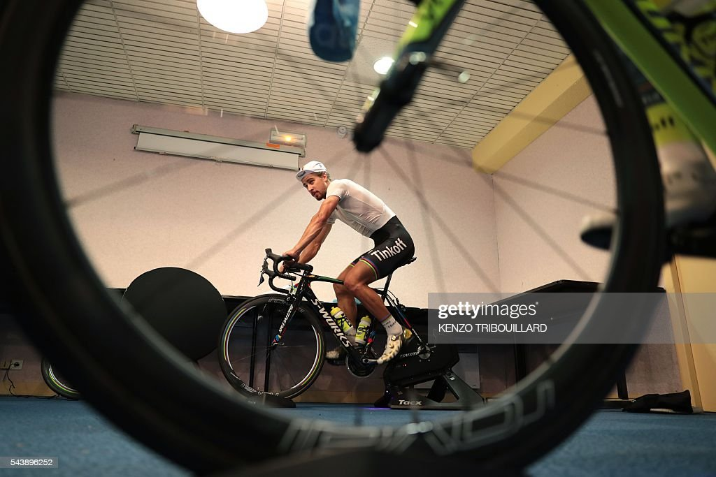 Slovakia's Peter Sagan trains in his hotel, in Coutances, on July 30, 2016, two days before the start of the 103rd edition of the Tour de France cycling race. The 2016 Tour de France will start on July 2 in the streets of Le Mont-Saint-Michel and ends on July 24, 2016 down the Champs-Elysees in Paris. / AFP / KENZO