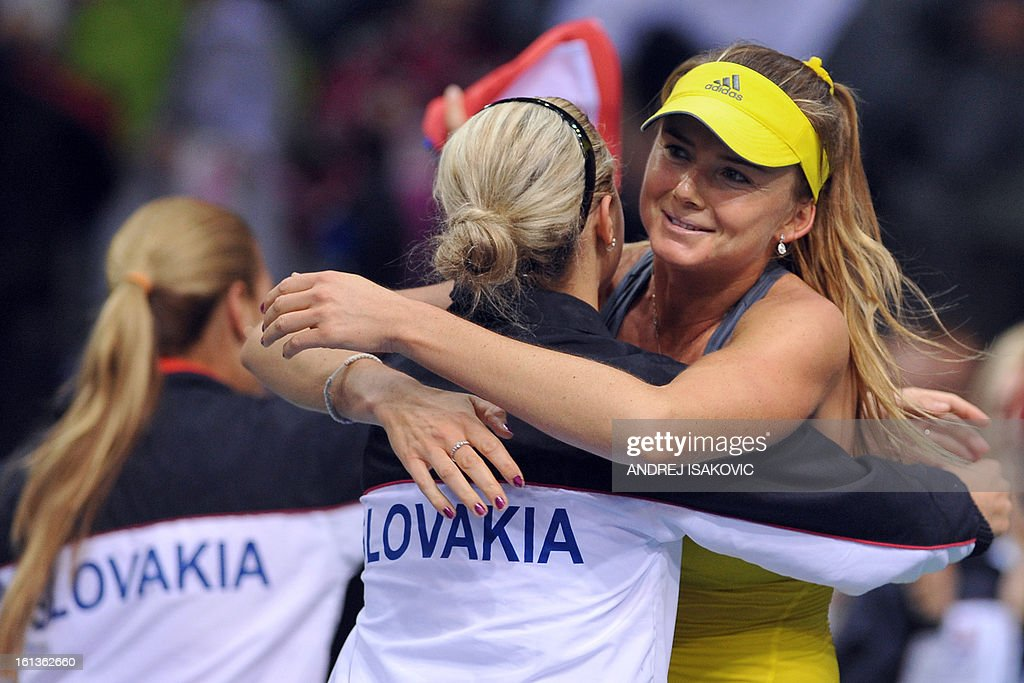 Slovakia's player Daniela Hantuchova (R) celebrates her victory against Serbia's Vesna Dolonc during the Fed cup World group first round tie tennis match between Serbia and Slovakia on February 10, 2013, in Nis.