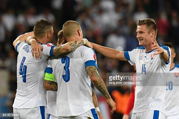 TOPSHOT Slovakia's players celebrate after the Euro 2016 group B football match between Slovakia and England at the GeoffroyGuichard stadium in...