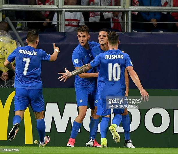 Slovakia's players celebrate scoring during the UEFA U21 European Championship Group A football match Poland v Slovakia in Lublin Poland on June 16...