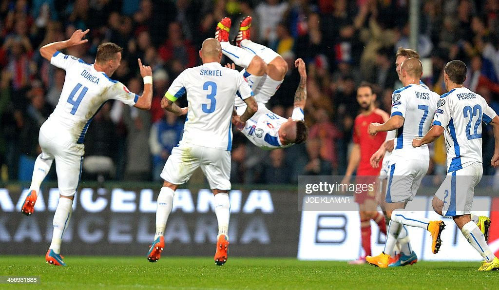 Slovakia's players celebrate their 10 goal during Euro 2016 qualifing football match between Slovakia and Spain in northern Slovak town of Zilina on...