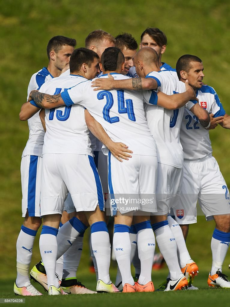 Slovakia's players celebrate their 1:0 goal during the friendly match between Slovakia and Georgia in Wels, Austria on May 27, 2016. / AFP / JOE