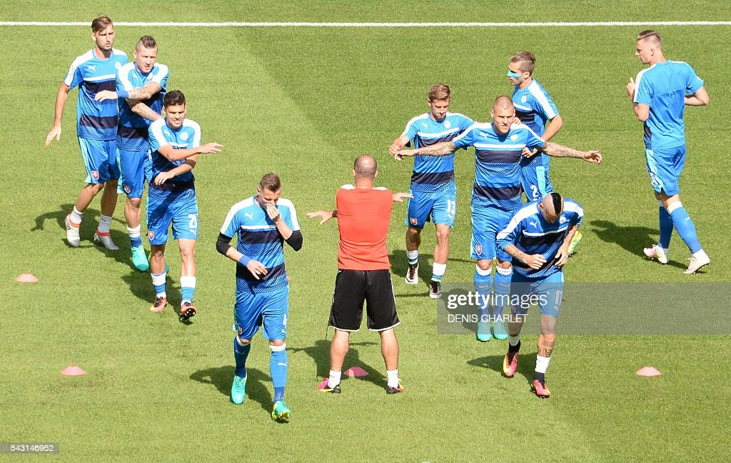 Slovakia's players warm-up during Euro 2016 round of 16 football match between Germany and Slovakia at the Pierre-Mauroy stadium in Villeneuve-d'Ascq, near Lille, on June 26, 2016. / AFP / DENIS