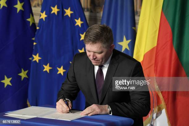 Slovakia's Prime Minister Robert Fico signs the new Rome declaration with leaders of 27 European Union countries special during a summit of EU...