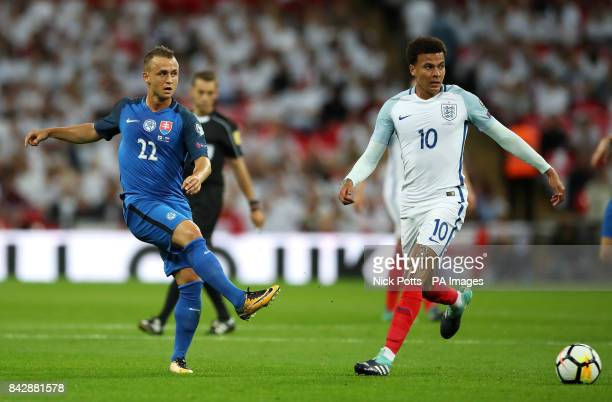 Slovakia's Stanislav Lobotka and England's Dele Alli in action