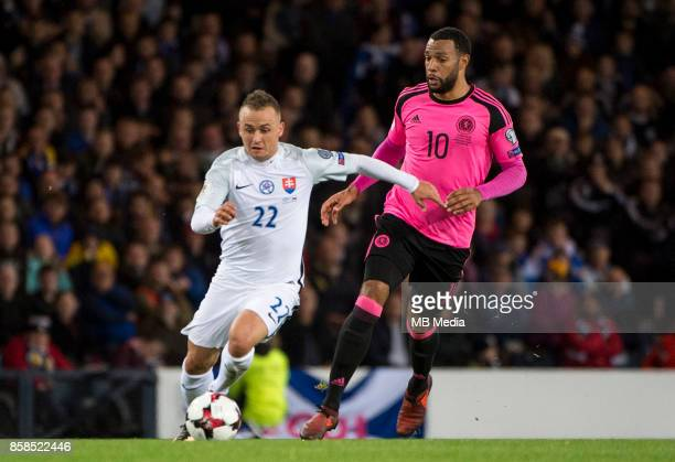 Slovakia's Stanislav Lobotka and Matt Philips compete for the ball during the match between Scotland and Slovakia at Hampden Park on October 52017 in...
