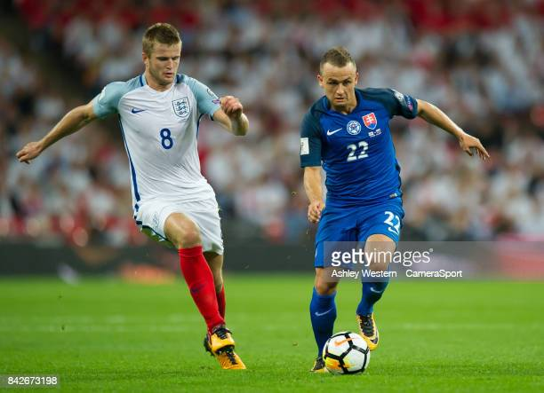 Slovakia's Stanislav Lobotka holds off the challenge from England's Eric Dier during the FIFA 2018 World Cup Qualifier between England and Slovakia...