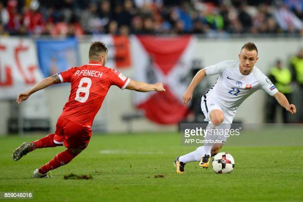 Slovakia's Stanislav Lobotka vies with Malta's Paul Fenech during the FIFA World Cup 2018 qualification football match between Slovakia and Malta in...