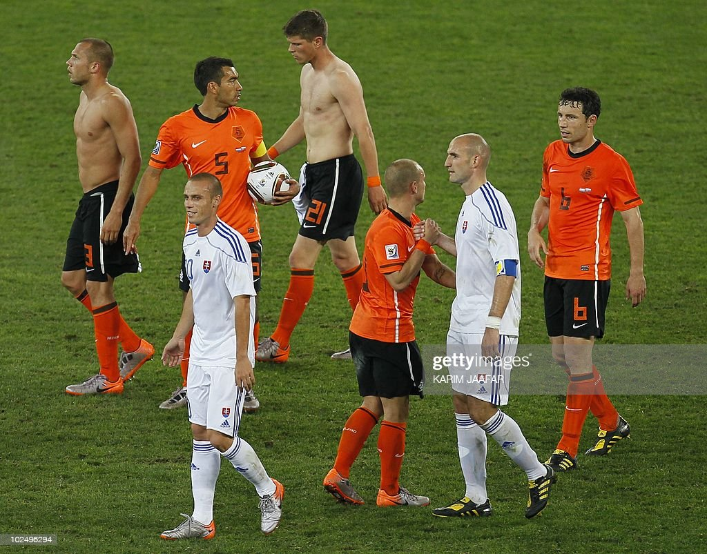 Slovakia's striker Robert Vittek (2nd-R) and midfielder Kamil Kopunek (front-L) walk off the pitch with Netherlands' players at the end of their 2010 World Cup round of 16 football match on June 28, 2010 at the Moses Mabhida Stadium in Durban. Netherlands won 2-1. NO