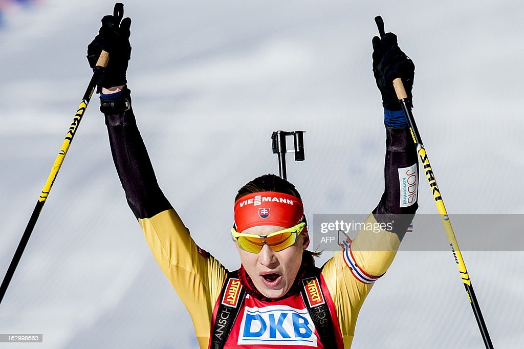 Slovakia's third placed Anastasiya Kuzmina reacts after competing in the women's 12,5 km mass start race Biathlon World Cup in Oslo on March 3, 2013. AFP PHOTO / STIAN LYSBERG SOLUM / SCANPIX NORWAY / NORWAY OUT