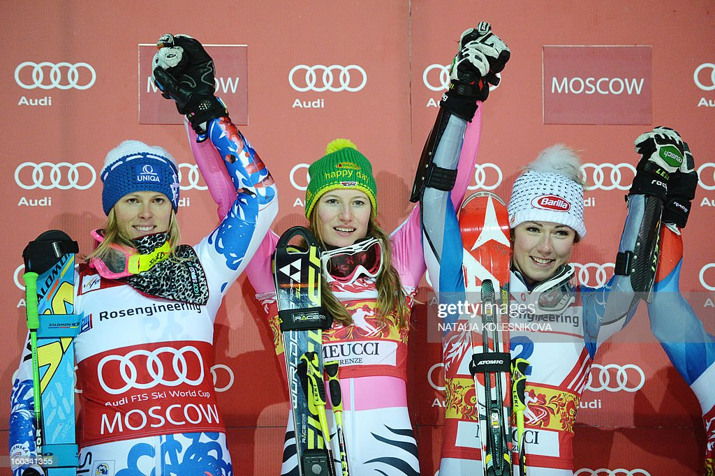 Slovakia's Veronika Velez-Zuzulova (second place), Germany's Lena Duerr (first place) and Mikaela Shiffrin of USA (third place) celebrate on the podium after the FIS Ski World Cup Parallel Slalom city event in Moscow on January 29, 2013. AFP PHOTO / NATALIA KOLESNIKOVA