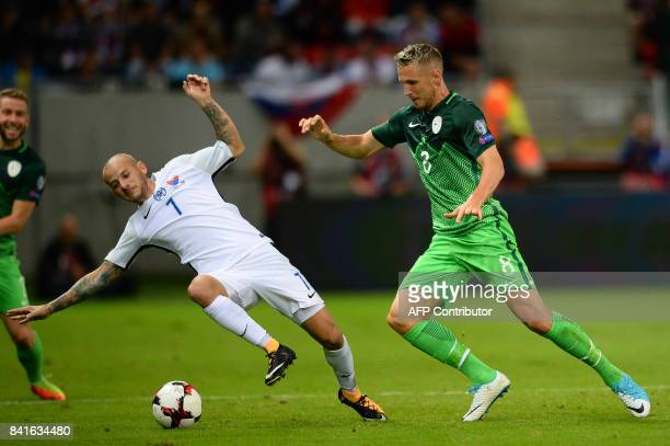 Slovakia's Vladimir Weiss and Slovenia's Jasmin Kurtic vie for the ball during the FIFA World Cup 2018 qualification football match between Slovakia...