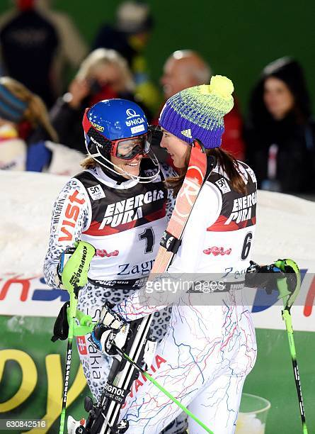 Slovakia's winner Veronika Velez Zuzulova and Slovakia's second placed Petra Vlhova celebrate on the finish line after the FIS alpine women's slalom...