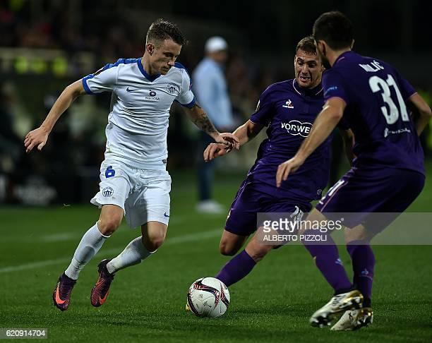 FC Slovan Liberec midfielder Jan Sykora from Czech Republic fights for the ball with Fiorentina's midfielder Sebastian Cristoforo from Uruguay and...