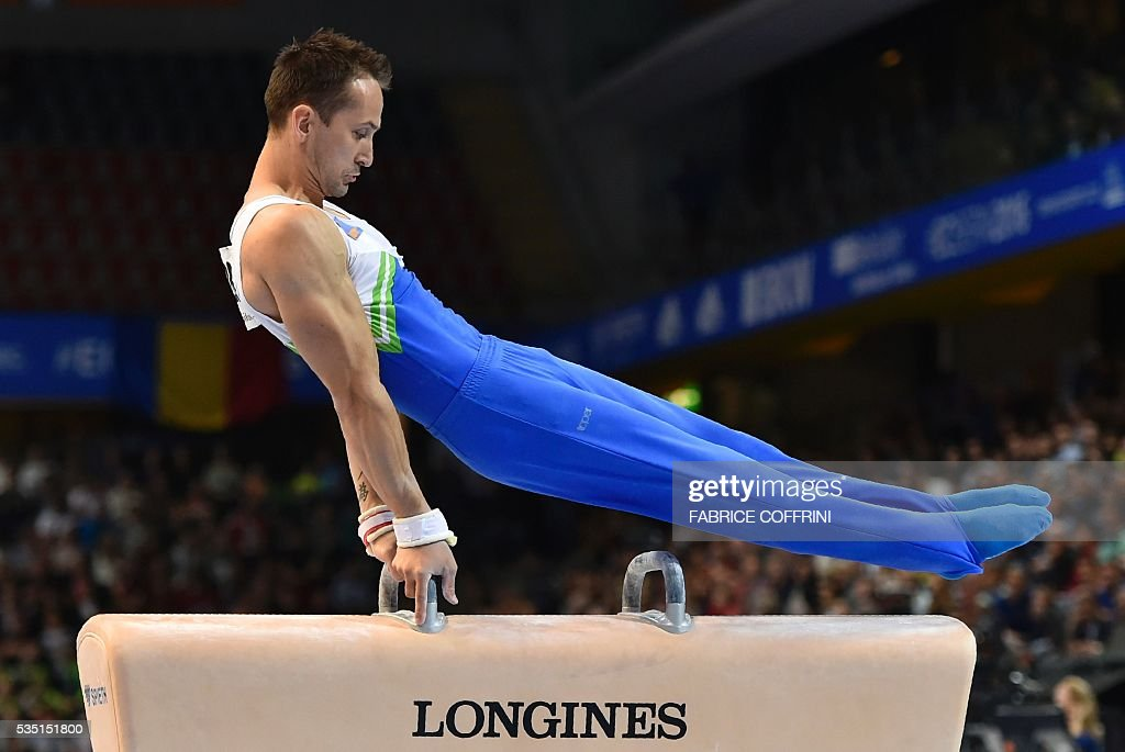 Slovanias Saso Bertoncelj performs during the Mens Pommel Horse competition of the European Artistic Gymnastics Championships 2016 in Bern, Switzerland on May 29, 2016. / AFP / FABRICE