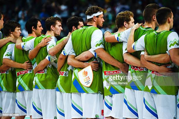 Slovenia Basketball Men's National Team stand listening the national anthem prior to the 2014 FIBA Basketball World Cup quarterfinal match between...