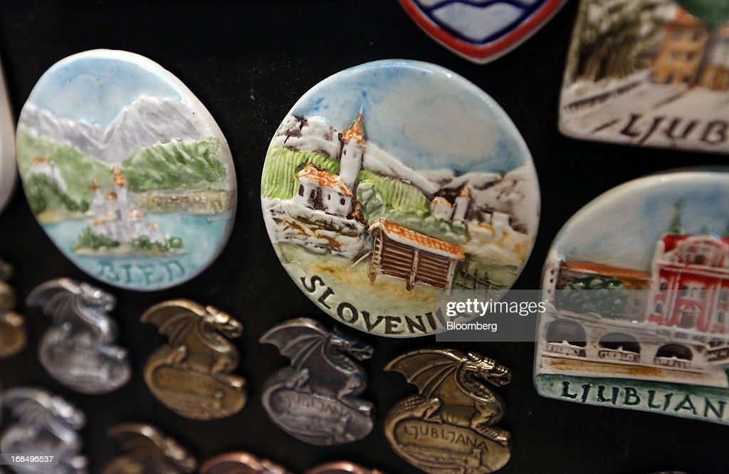 Slovenia branded fridge magnets sit for sale in a tourist store in Ljubljana, Slovenia, on Thursday, May 9, 2013. The Adriatic nation is seeking to fix its ailing lenders with a cash injection of at least 900 million euros ($1.17 billion) after Cyprus's bailout focused investors on countries with weak banking industries. Photographer: Chris Ratcliffe/Bloomberg via Getty Images