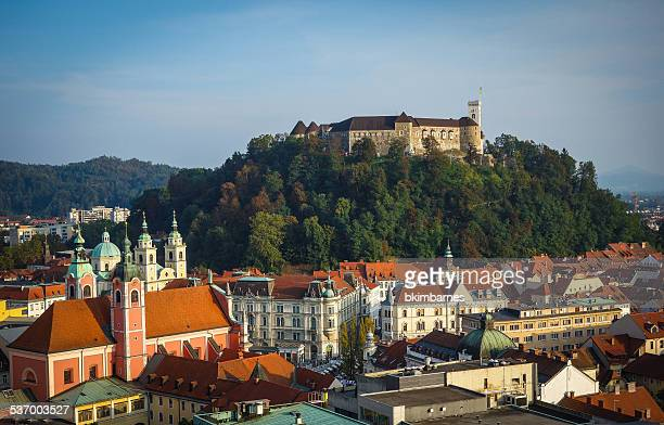 Slovenia, Ljubljana, Castle on wooded hill and surrounding cityscape