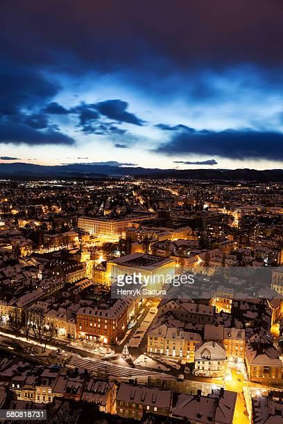 Slovenia, Ljubljana, Illuminated cityscape at dusk