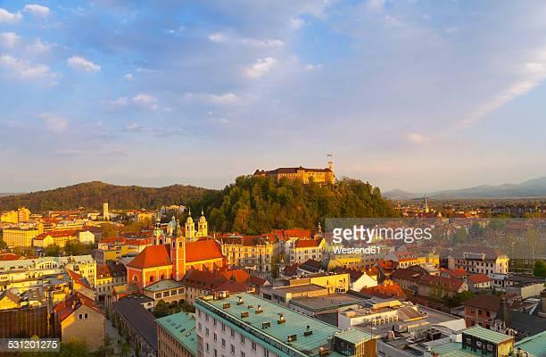 Slovenia, Ljubljana, Ljubljana city center, Ljubljana Castle and Franciscan Church of the Annunciation in the evening light