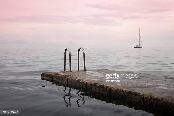 Slovenia, Piran, view to bathing jetty at twilight