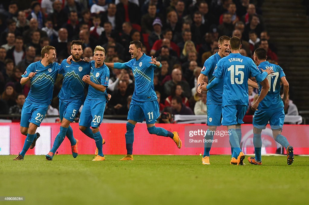Slovenia players celebrate the England owngoal that saw them take the lead 10 during the EURO 2016 Qualifier Group E match between England and...
