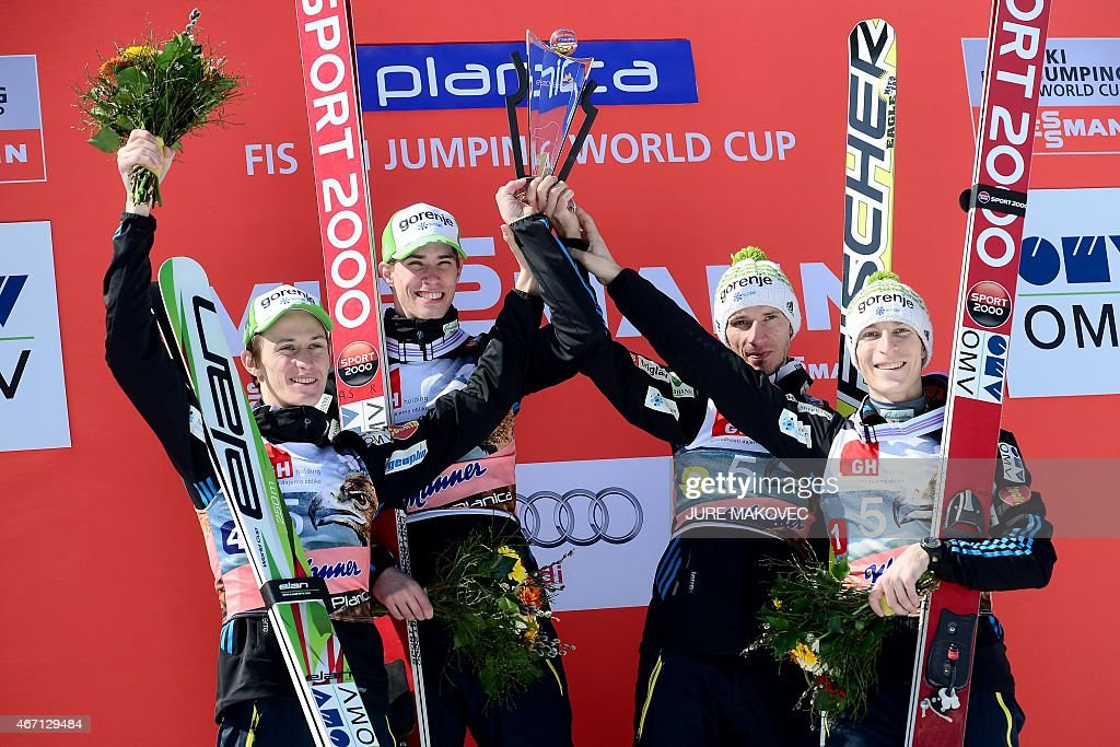 Slovenia winning team members <a gi-track='captionPersonalityLinkClicked' href=/galleries/search?phrase=Peter+Prevc&family=editorial&specificpeople=6667561 ng-click='$event.stopPropagation()'>Peter Prevc</a>, Anze Semenic, <a gi-track='captionPersonalityLinkClicked' href=/galleries/search?phrase=Robert+Kranjec&family=editorial&specificpeople=722812 ng-click='$event.stopPropagation()'>Robert Kranjec</a> and <a gi-track='captionPersonalityLinkClicked' href=/galleries/search?phrase=Jurij+Tepes&family=editorial&specificpeople=4782766 ng-click='$event.stopPropagation()'>Jurij Tepes</a> celebrate on the podium on the podium during the FIS Ski Flying World Cup Team Event in Planica, Slovenia on March 21, 2015. MAKOVEC