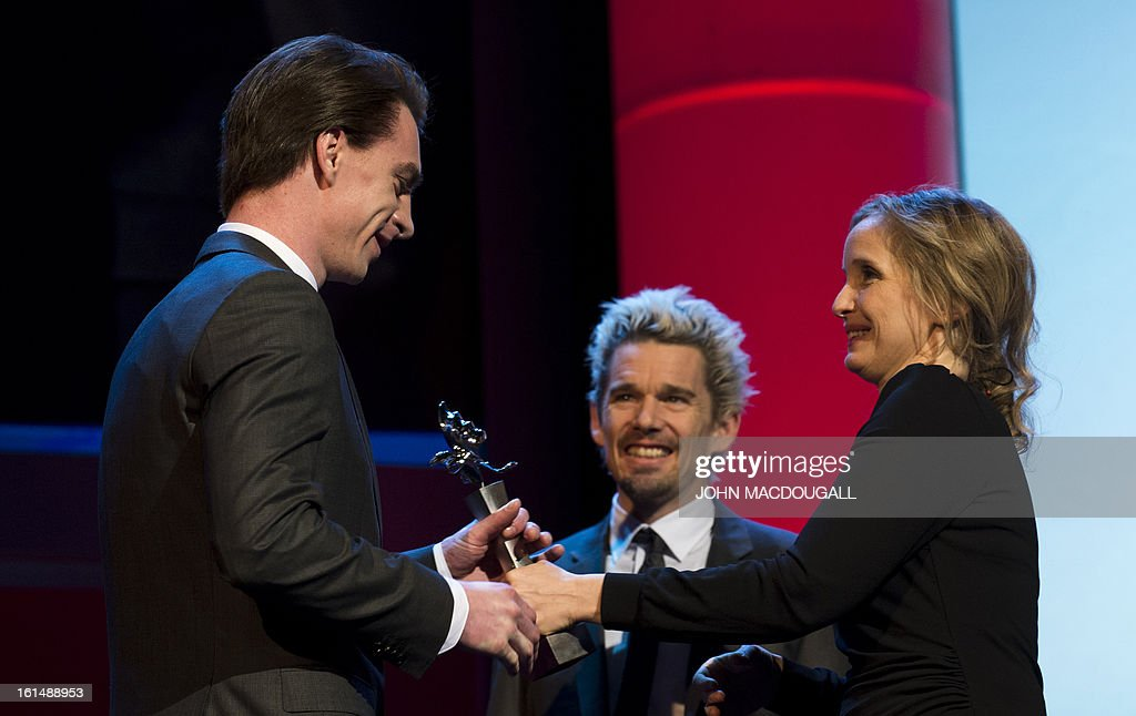 Slovenian actor Jure Henigman receives his Shooting Star award from French actress Julie Delpy during the 63rd Berlinale Film Festival in Berlin February 11, 2013. The Shooting Star awards reward Europe's best young promising actors.
