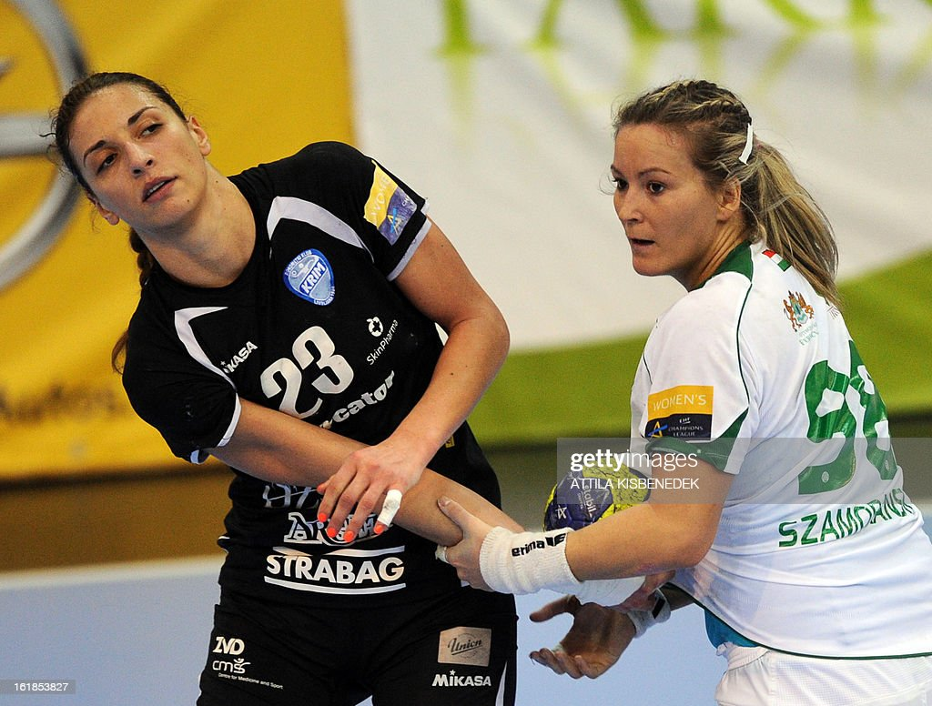 Slovenian Andrea Penezic (L) of RK Krim Mercator is fouled by Hungarian Piroska Szamoransky (R) of FTC Rail Cargo Hungaria in the local sports hall of Dabas on February 17, 2013 during their EHF Women's Champions League handball match. AFP PHOTO / ATTILA KISBENEDEK